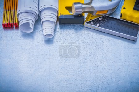 building working tools on metallic background