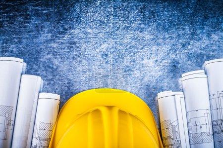 Architectural construction plans with building helmet
