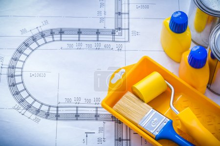 Construction plan with paint brush