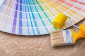 Paint brush, roller and color palette