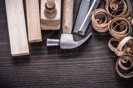 planer hammer, chisels, wooden studs