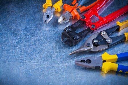 Set of bolt cutter, tin snips, cutting pliers