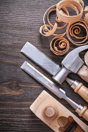 hammer, flat chisels and curled shavings