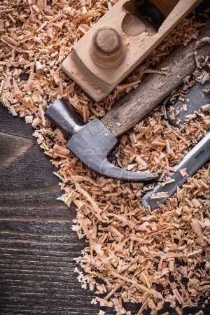 hammer, chisels wooden planer and shavings