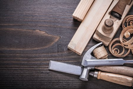 hammer, metal chisels and curled shavings
