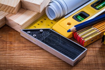 Square ruler, blueprints and wooden meter