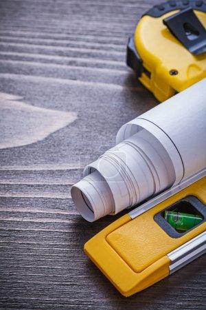 Blueprints, tape-line and construction level