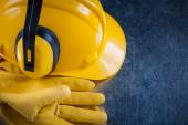 Hard hat, ear muffs and gloves