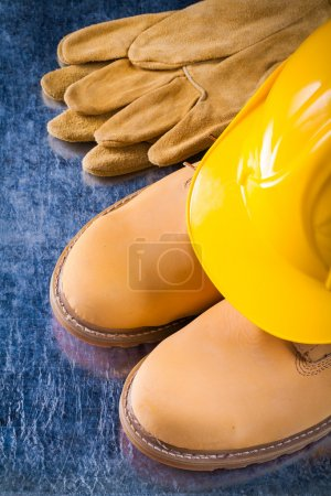 waterproof boots, gloves and working helmet