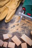 Electric jigsaw sawdust, working gloves