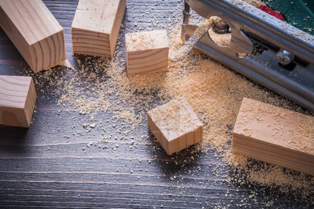 Electric jigsaw sawdust and wooden planks