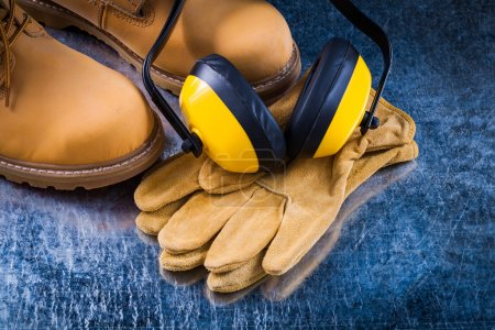 Safety boots, gloves and ear muffs