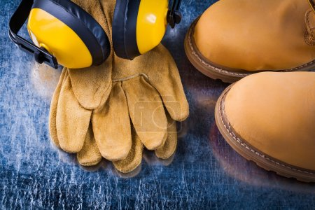 Safety boots, leather gloves and headphones