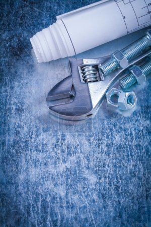 spanner, construction nuts, bolts and blueprints