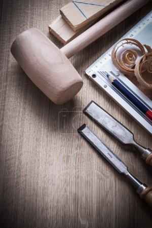 Wooden bricks, hammer, chisels