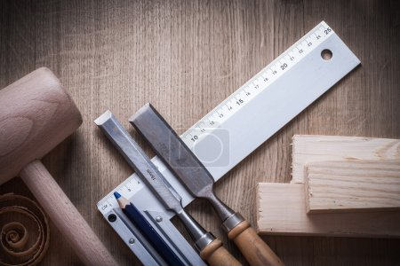 Wooden bricks, hammer, firmer chisels