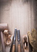 Wooden bricks, hammer, leather gloves