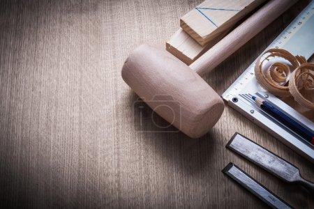 bricks, mallet, chisels, pencil