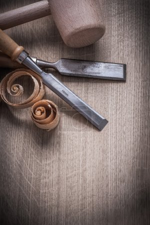 Wooden hammer, flat chisels