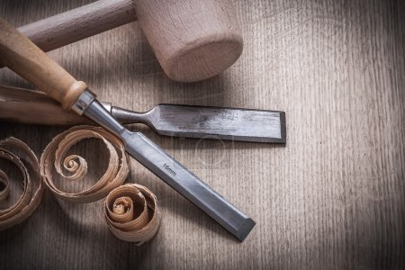 Wooden hammer, planning chips, chisels
