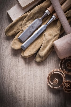 Wooden planks, hammer, working gloves