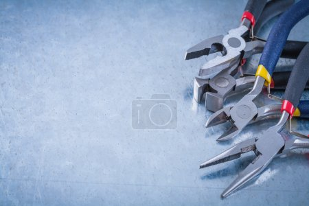 Photo for Insulated electric wire cutters on scratched metallic background, construction concept. - Royalty Free Image