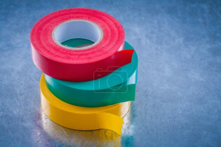 Insulating tapes on scratched metallic background,...