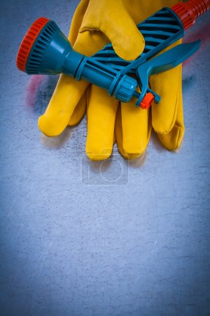Protective gloves with hose spraying nozzle