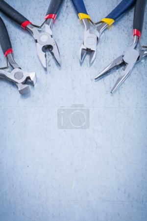Photo for Set of electric metal nippers on scratched metallic background, copyspace. - Royalty Free Image