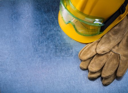 working gloves, building helmet and glasses