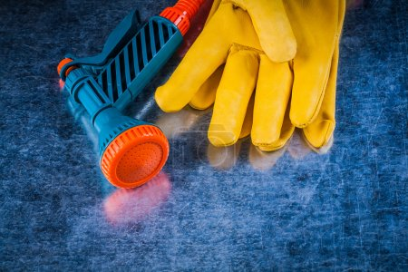 leather protective gloves and hose nozzle
