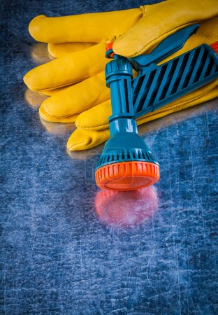 Yellow gardening gloves and water sprayer