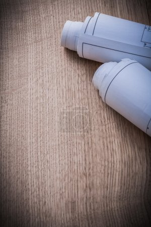 Blueprint rolls on wooden background