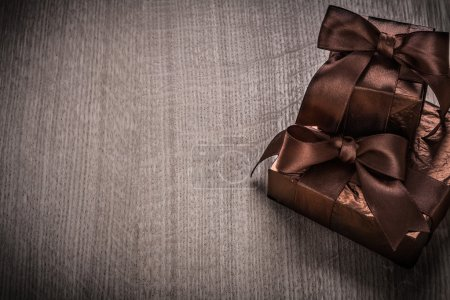 Gifts boxed in glittery paper with ribbons
