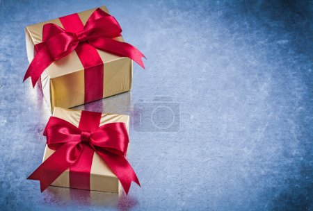 Packed golden gifts with red bows