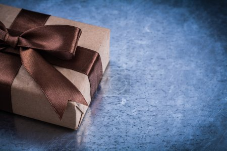 present boxe with brown ribbon