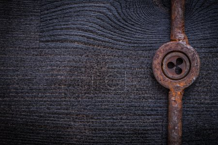 Photo for Vintage rusted die with holder copyspace. - Royalty Free Image