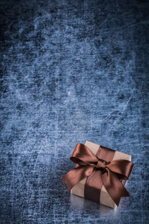 Packed present box on metallic background