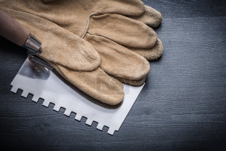 pair gloves and putty knife