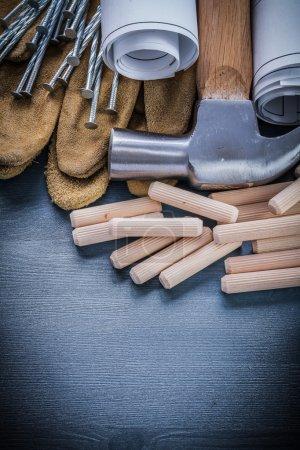 dowels hammer blueprints nails gloves