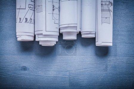 White rolls of blueprints