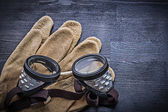Close-up of goggles on gloves
