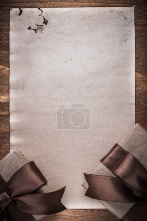 Giftboxes with brown bows and paper