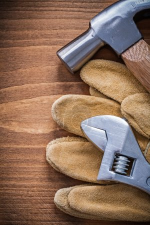 claw hammer and safety gloves