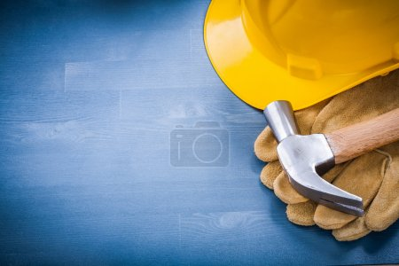 Photo for Hard hat and claw hammer protective gloves copy space construction concept - Royalty Free Image