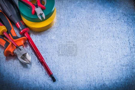 Photo for Set of cutting pliers and insulation screwdrivers insulating tapes - Royalty Free Image