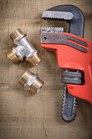 Pipe wrench and plumbing fixtures