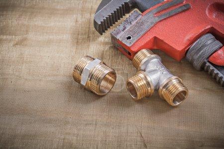 Plumbers wrench and plumbing fixtures