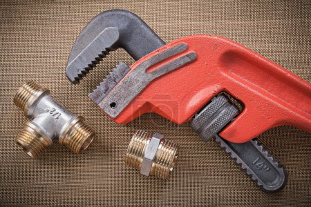 Monkey wrench and brass plumbing fixtures