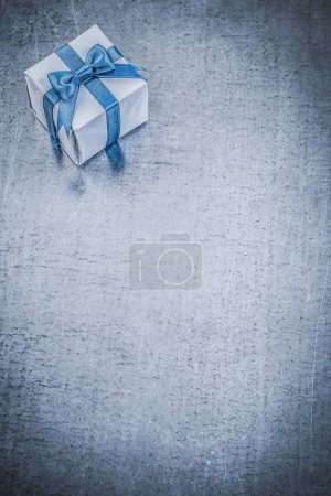 Gift box on scratched metal